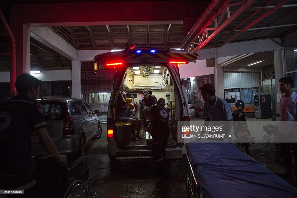 This picture taken on May 28 2016 shows Vientiane Rescue volunteers arriving at a hospital with a person injured during a road accident in Vientiane...