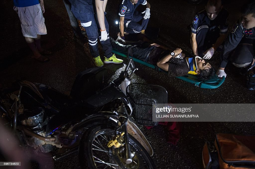 This picture taken on May 28 2016 shows Vientiane Rescue volunteers attending to a person involved in a motorcycle accident in Vientiane Laos Founded...