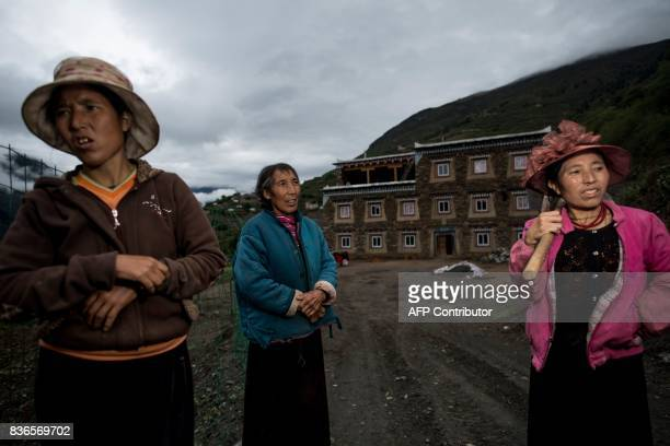 This picture taken on May 28 2017 shows 60yearold matriarch Dolma Lhamo with her daughters standing in front of a house in Zhaba in the valley of the...
