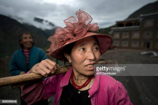 This picture taken on May 28 2017 shows 60yearold matriarch Dolma Lhamo with one of her two daughters in front of a house in Zhaba in the valley of...