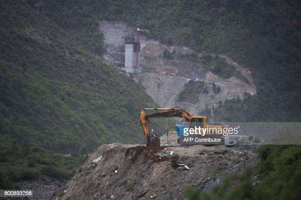 This picture taken on May 28 2017 shows a construction site for a road near the Lianghekou dam near Hekou in Sichuan province Towering walls of...