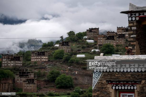 This picture taken on May 28 2017 shows a daughter of 60yearold matriarch Dolma Lhamo standing in the balcony of a house in Zhaba in the valley of...