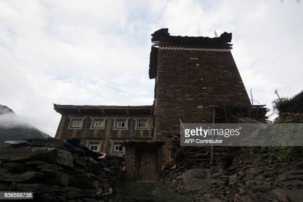 This picture taken on May 28 2017 shows a house in Zhaba in the valley of the Yalong River in Daofu County of the Garze Tibetan Autonomous Prefecture...