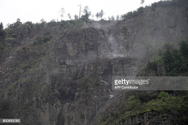 This picture taken on May 28 2017 shows a stone avalanche caused by the construction site of a street near the the Lianghekou dam near Hekou in...