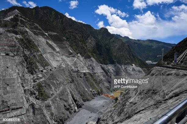 This picture taken on May 28 2017 shows a view of the construction site of the Lianghekou dam near Hekou in Sichuan province Towering walls of...