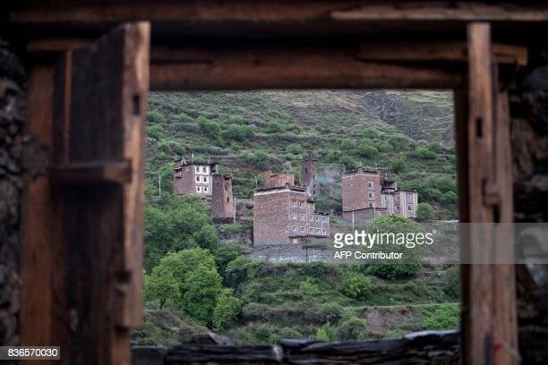 This picture taken on May 28 2017 shows houses in Zhaba in the valley of the Yalong River in Daofu County of the Garze Tibetan Autonomous Prefecture...