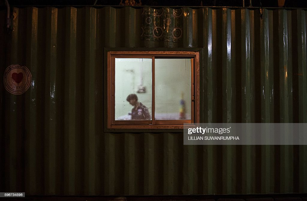 This picture taken on May 29 2016 shows a Vientiane Rescue volunteer inside one of their outposts consisting of a metal shipping container in...