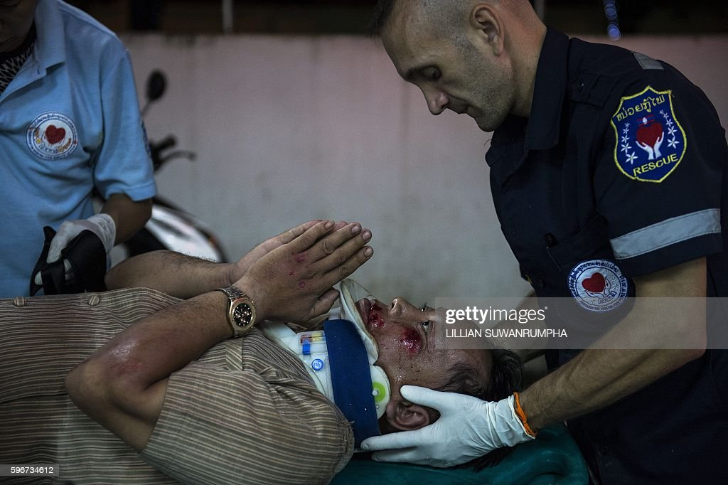 This picture taken on May 29 2016 shows an injured motorcycle driver under the influence of alcohol thanking Vientiane Rescue founder Sebastien...