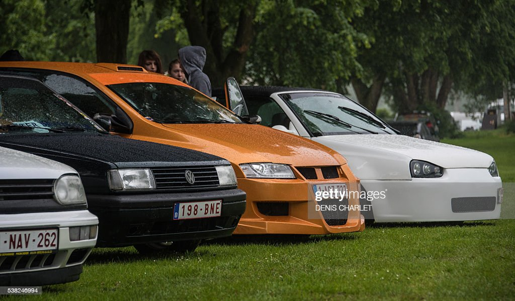 This picture taken on May 29 2016 shows tuned car parked in a field during a tuning meeting in Harnes in the suburb of Lens northern France Big...