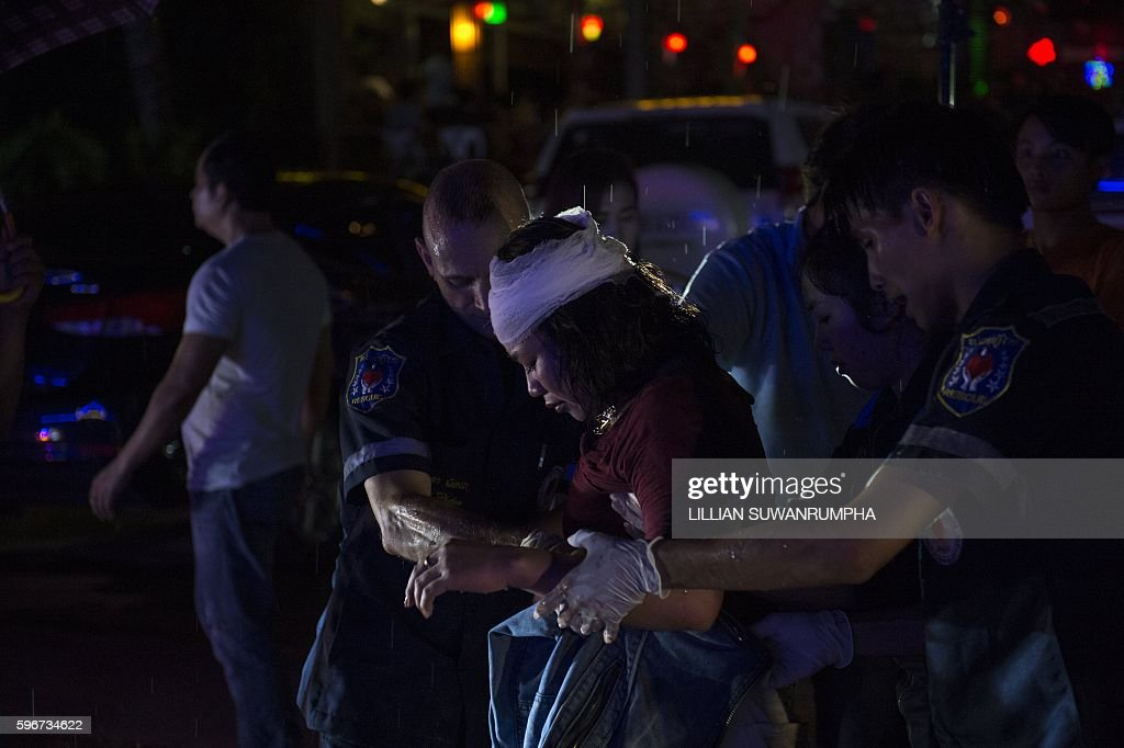 This picture taken on May 29 2016 shows Vientiane Rescue volunteers helping a victim of an assault outside a bar in Vientiane Laos Founded in 2010 by...