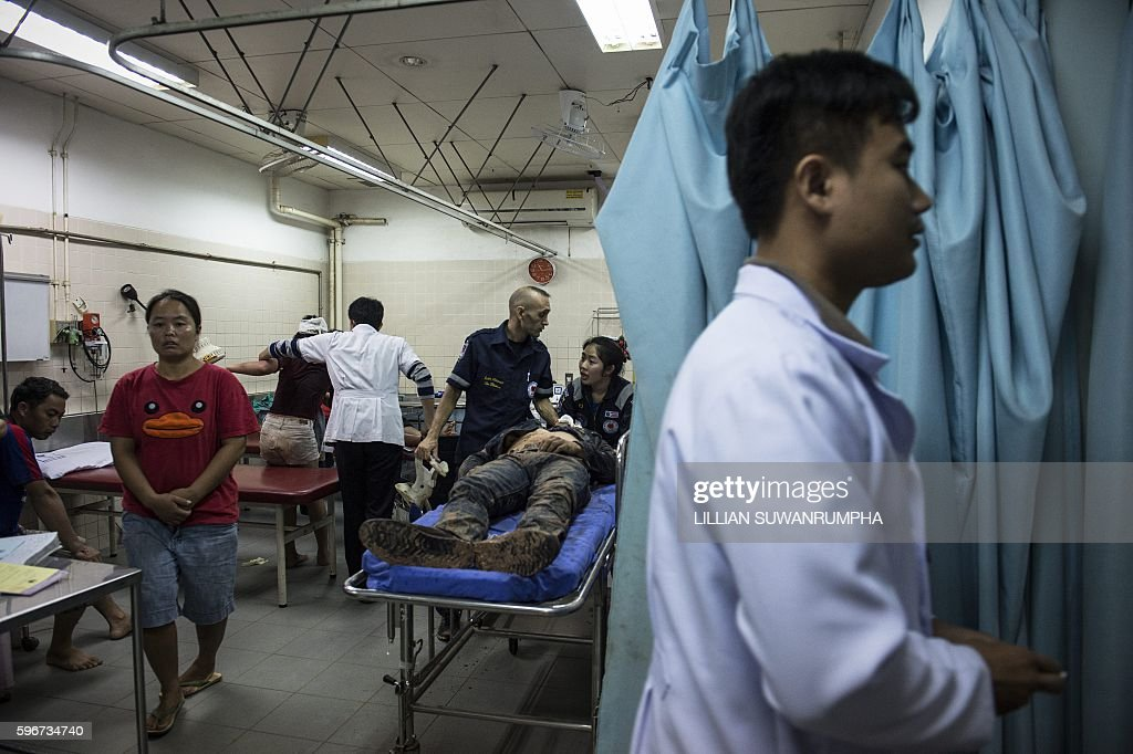 This picture taken on May 29 2016 shows Vientiane Rescue volunteers waiting inside a hospital with a person involved in a road accident in Vientiane...