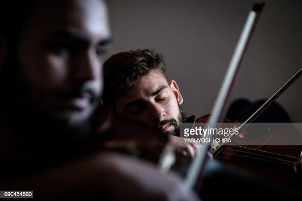 This picture taken on May 29 2017 shows members of Orquestra Mare do Amanha an orchestra based on a social project founded in 2010 in one of the most...