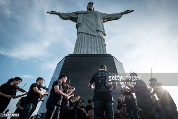 TOPSHOT This picture taken on May 29 2017 shows members of Orquestra Mare do Amanha an orchestra based on a social project founded in 2010 in one of...
