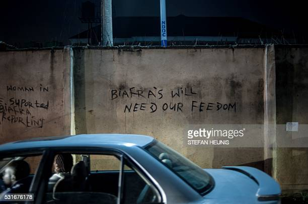 This picture taken on May 3 shows ProBiafran graffiti messages in Port Hardcourt Over the past year Biafran independence protests have erupted across...