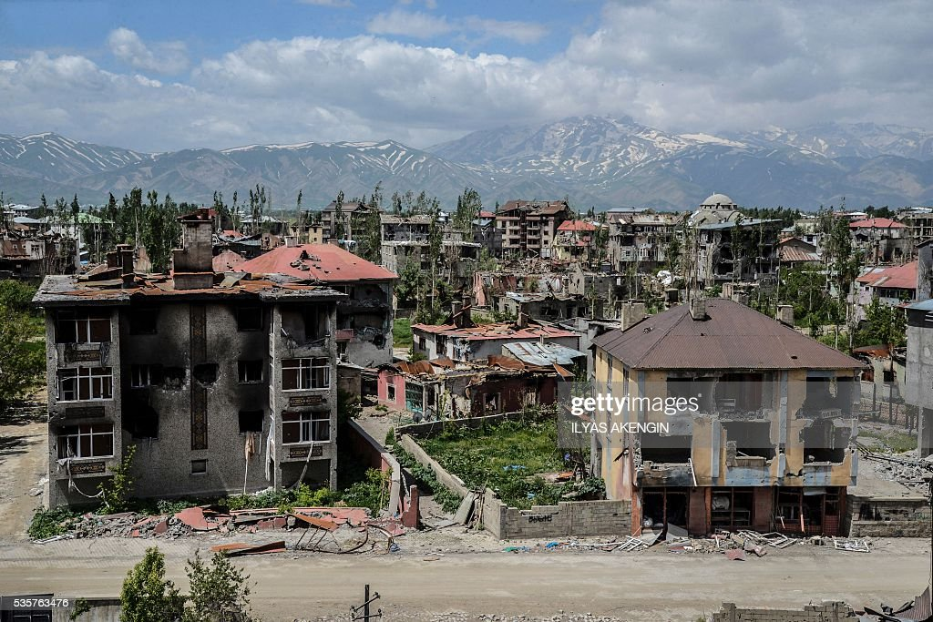 This picture taken on May 30, 2016 shows a general view of damaged buildings after heavy fightings between Turkish government troops and Kurdish fighters after the curfew in the southeastern Turkey Kurdish town of Yuksekova, near the border with Iraq and Iran. / AFP / ILYAS
