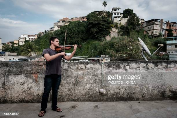 This picture taken on May 30 2017 shows Michel Dionisio a 19yearold violinist from the Orquestra Mare do Amanha an orchestra based on a social...