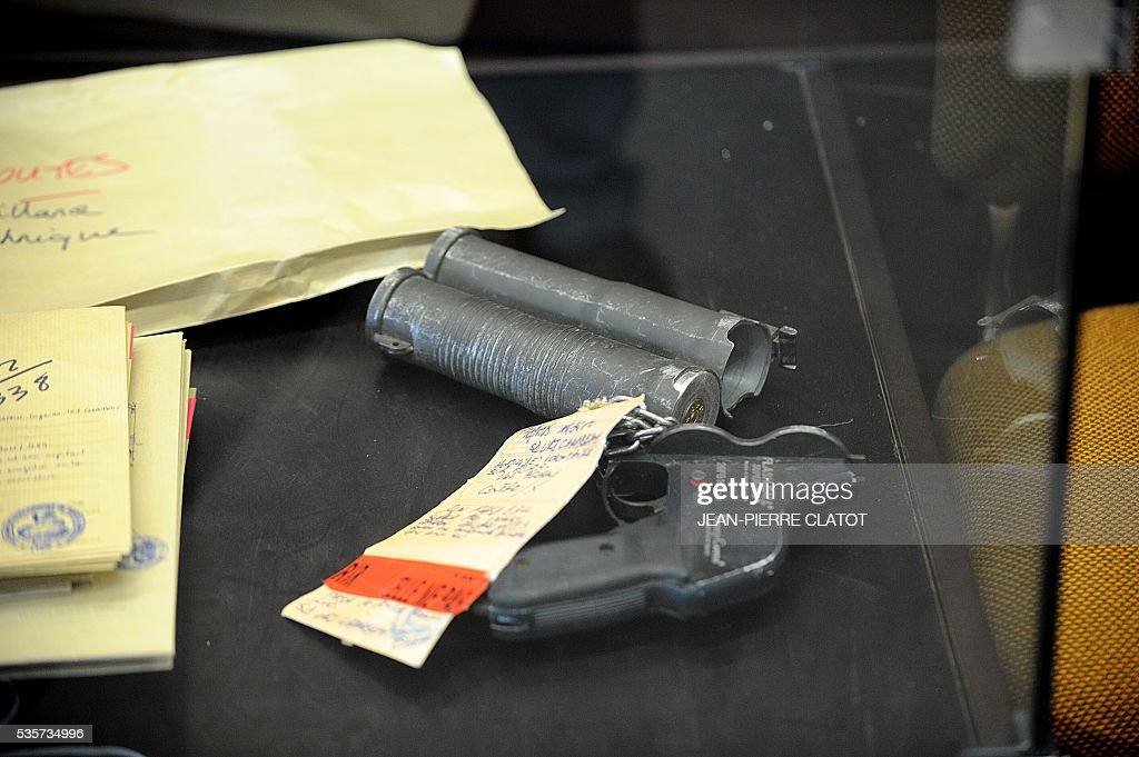 This picture taken on May 30, 2016, shows pieces of evidence presented at the Assises court in Chambery on May 30, 2016 before the trial of four armed robbers who are accused of killing a police officer of the French police's organized crime squad (BAC) during a robbery of electronics and white goods company Darty, in Chambery, southeast France. A police officer of the French police's organized crime squad (BAC) was killed in April 2012 by armed robbers who hit him with their car after they robbed electronics and white goods company Darty. / AFP / JEAN