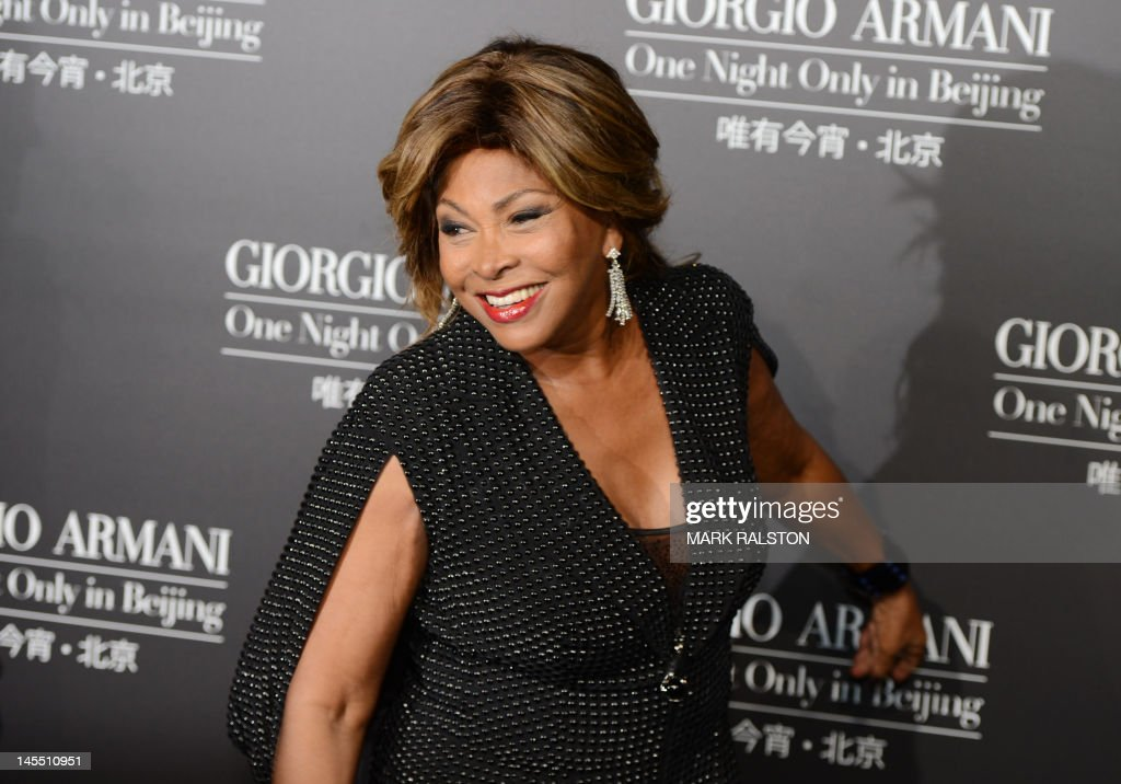 This picture taken on May 31, 2012 shows singer Tina Turner arriving on the red carpet for the fashion show by 77-year-old designer Giorgio Armani at the 798 art complex in Beijing. Entitled 'One Night Only in Beijing', the show presented 12 autumn/winter collections and was billed as a celebration of 'over a decade of Armani in China'. AFP PHOTO/Mark RALSTON