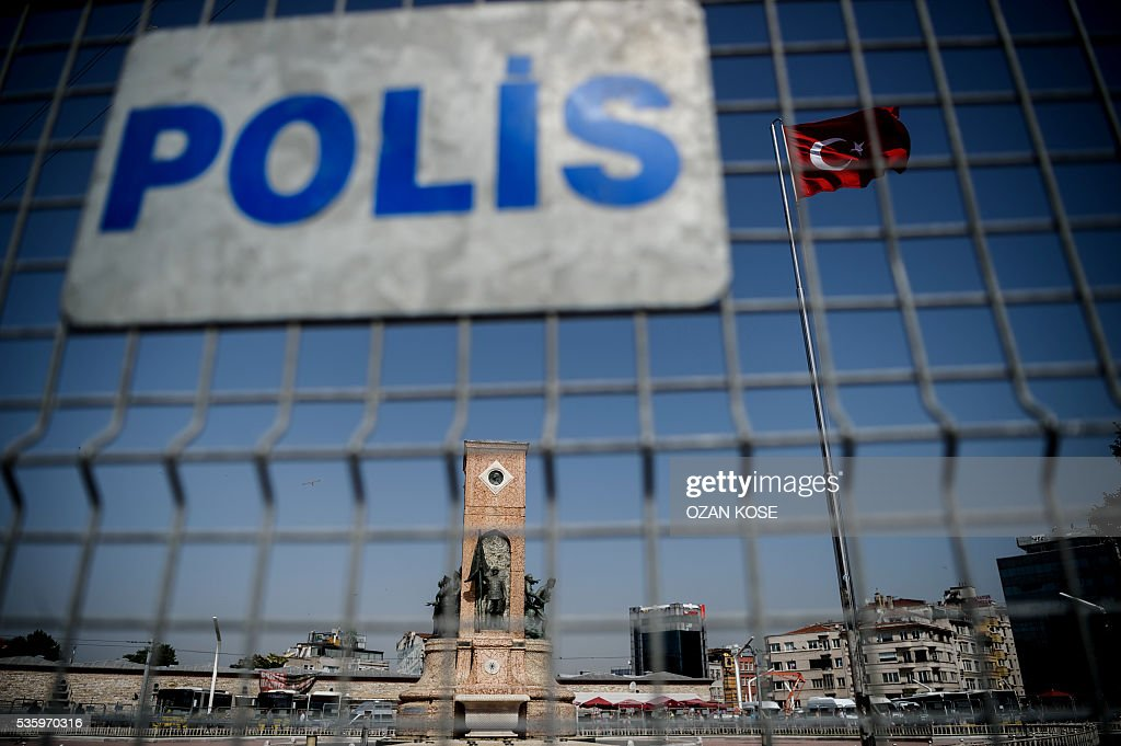 This picture taken on May 31, 2016 shows a general view of the Republic monument through a police barricade erected around Takism Square in Istanbul on the third anniversary of the start of the Gezi Park protests. The Gezi Park protests which began in May 2013, were sparked by the heavy-handed eviction of demonstrators staging a sit-in protest against the redevelopment of the area and grew into often violent clashes with police as people demonstrated against much broader issues concerning perceived infringements of civil rights. / AFP / OZAN