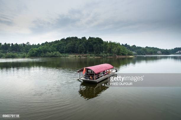 This picture taken on May 31 2017 shows principal Li Congshu's boat which is used to transport students across the Xiangshuitan reservoir in Dazu...