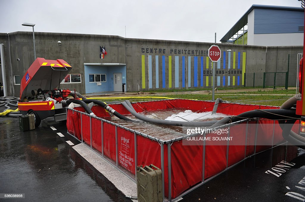 This picture taken on May 31, 2016, shows the entrance of the prison of Saran after heavy rainfalls partly flooded the prison. Some inmates were evacuated to other institutions as the Loiret department is under flood alert and France's weather agency Meteo France maintained on Tuesday 18 departments under orange alert. / AFP / GUILLAUME
