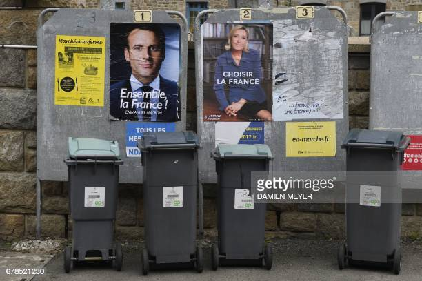 This picture taken on May 4 2017 shows election campaign posters of French presidential candidates Emmanuel Macron of the En Marche movement and...