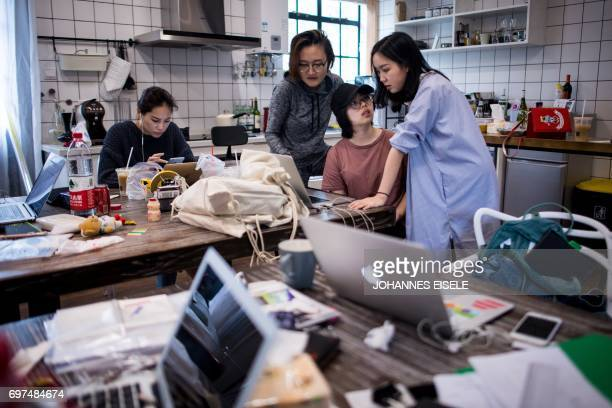 This picture taken on May 5 2017 shows employees of the ecommerce startup 'gogoand' working on their website in Shanghai Hordes of Chinese...