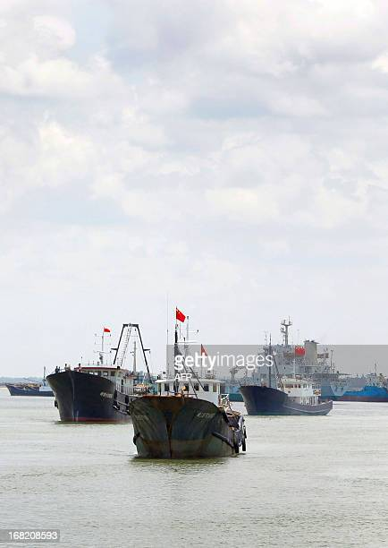 This picture taken on May 6 2013 shows fishing vessels setting sail for the Spratly Islands an archipelago disputed between China and other countries...
