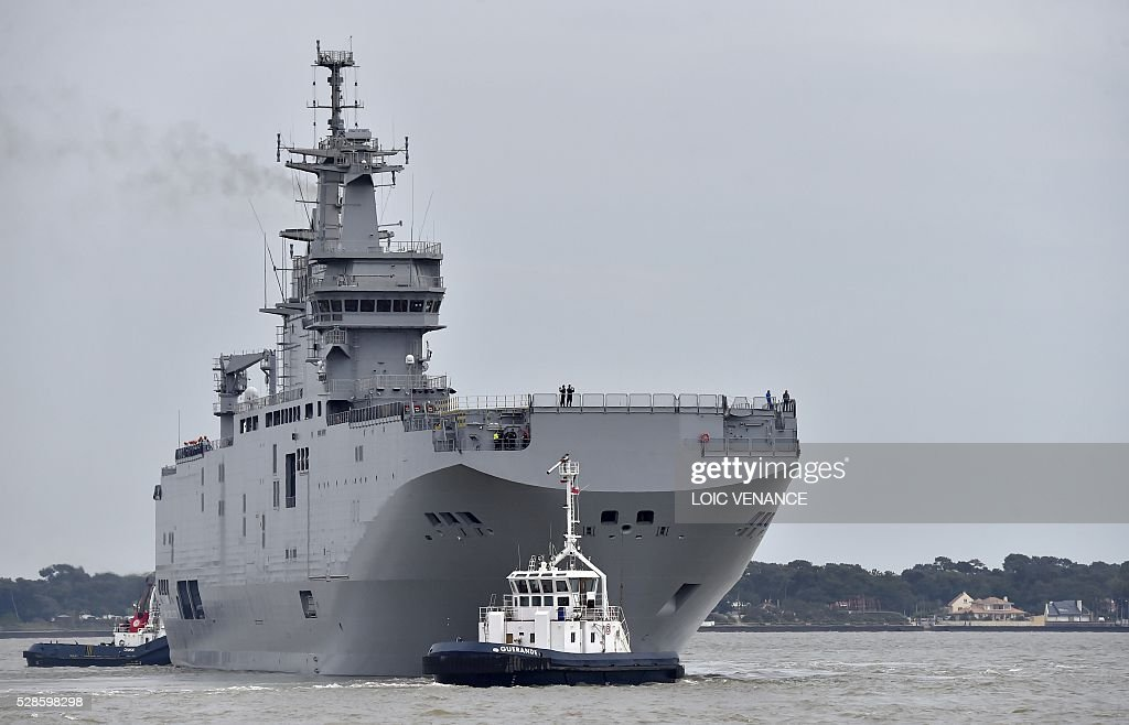 This picture taken on May 6, 2016, shows the Egyptian Gamal Abdl Nasser (ex-Vladivostok) Mistral class ship as it leaves the harbour for a one week training session in Saint-Nazaire, western France. The 'Nasser', first one of the two Mistral class ships sold by France to Egypt after its first sale cancellation to Russia, leaves Saint-Nazaire (Loire-Atlantique) on Friday for a week of Egyptian crew training at sea. / AFP / LOIC