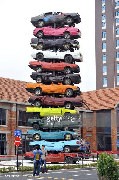 This picture taken on May 8 2013 shows a sculpture made of 13 retired cars in 'Jiangcheng No1' Creative Culture Park in Wuhan central China's Hubei...