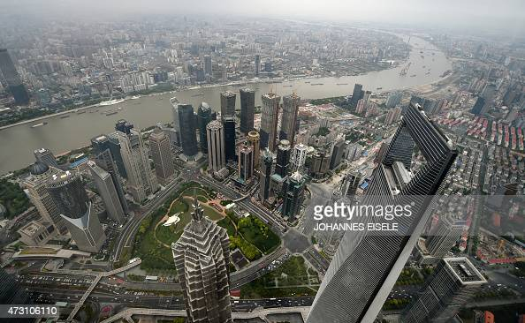 This picture taken on May 8 2015 shows a view of the Shanghai World Financial Center from the 120th floor of the new Shanghai Tower which is still...