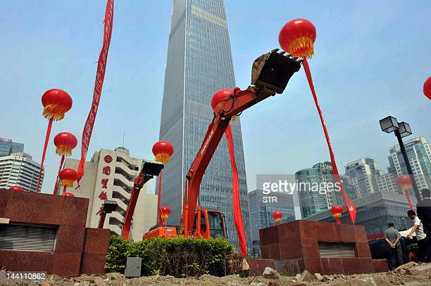 This picture taken on May 9 2012 shows a ground breaking ceremony for a new hotel in Beijing beside the city's tallest building the China World Tower...