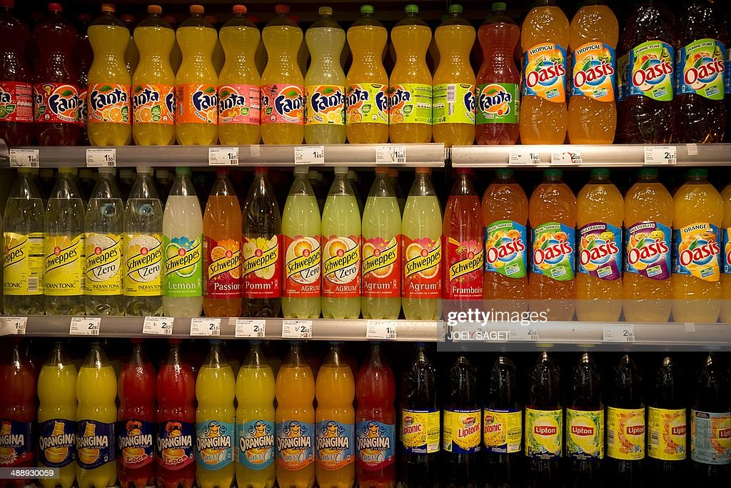 This picture taken on May 9, 2014 shows various soda bottles on a supermarket display in Paris, France.
