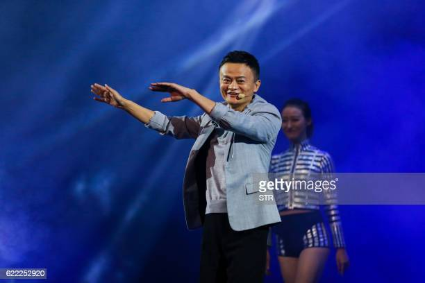 This picture taken on November 10 2016 shows Jack Ma Chairman of Alibaba Group performing on the stage during the 2016 Tmall 1111 Global Shopping...