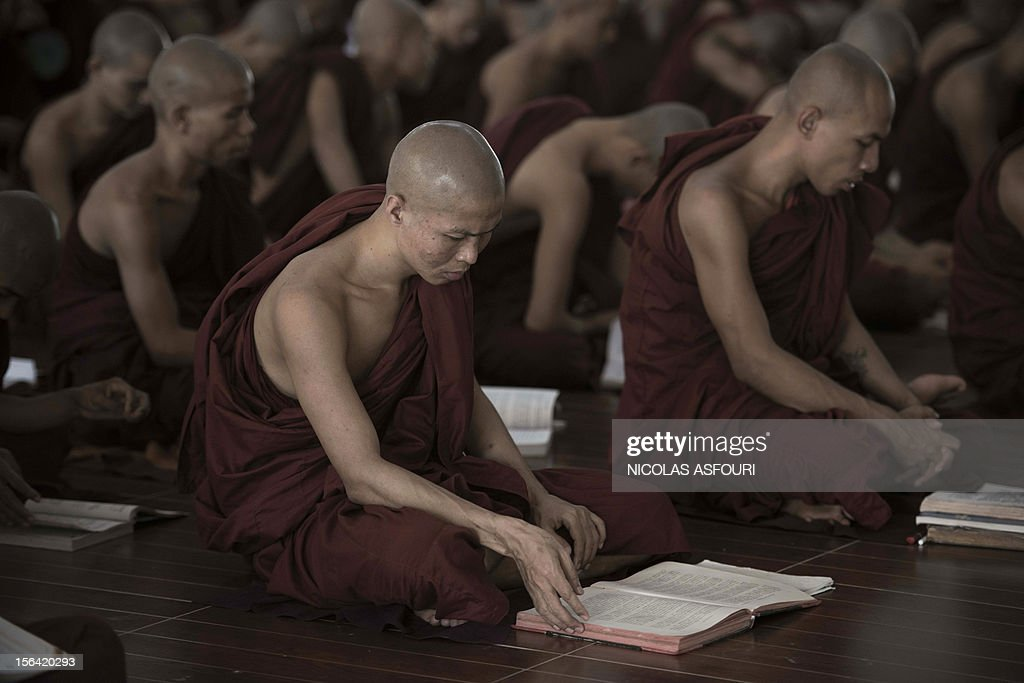 This picture taken on November 14, 2012 shows Buddhist monks studying at the Kyat Khat Wine monastery in Bago. Myanmar's government has said it 'warmly welcomes' the historic visit of US President Barack Obama later this month, expressing hope his trip will bolster the nation's political reform drive. AFP PHOTO / Nicolas ASFOURI