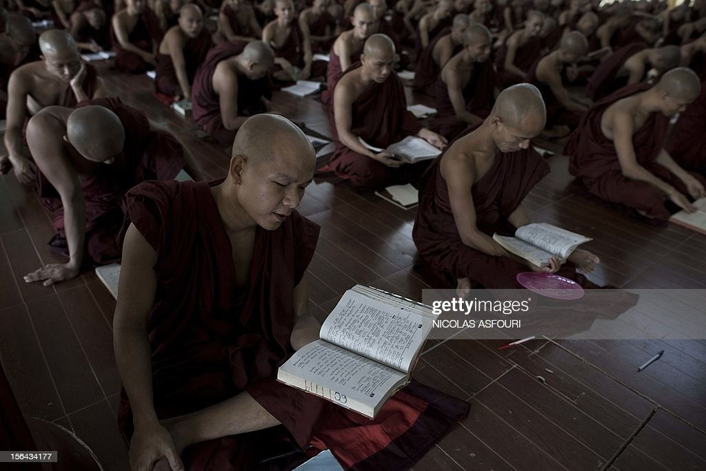 This picture taken on November 14, 2012 shows Buddhist monks studying at the Kyat Khat Wine monastery in Bago. Myanmar's government has said it 'warmly welcomes' the historic visit of President Barack Obama later this month, expressing hope his trip will bolster the nation's political reform drive. AFP PHOTO/ Nicolas ASFOURI