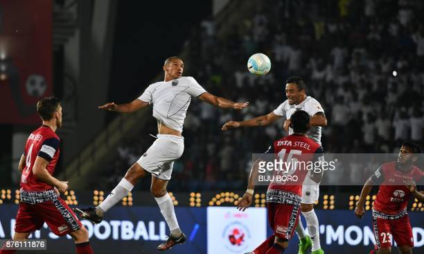 This picture taken on November 18 2017 shows Northeast United FCs forward Danilo Lopes Cezario jumping for the ball during the fourth season of the...