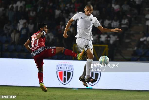 This picture taken on November 18 2017 shows Northeast United FCs forward Danilo Lopes Cezario vying for the ball with Jamshedpur FC midfield Souvik...