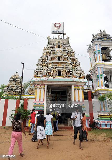 This picture taken on November 2 shows devotees gathering at the prominent Hindu temple of Koneswara in the eastern port district of Trincomalee some...