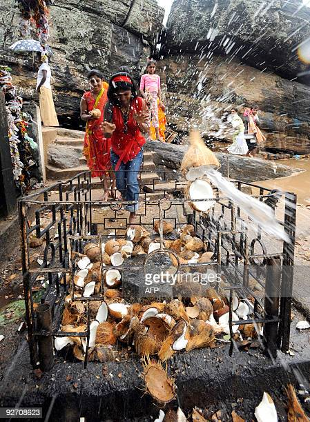 This picture taken on November 2 shows devotees performing rituals at the prominent Hindu temple of Koneswara in the eastern port district of...