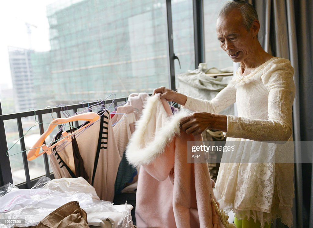 This picture taken on November 20, 2012 shows Liu Xianping who is a 72 year old grandfather preparing to model women's clothing for his granddaughter's (L) online fashion company 'Yecoo' in Guangzhou, south China's Guangdong province. Grandpa Liu who has become an internet sensation in China spent most of his life as a poor farmer in remote Hunan Province.