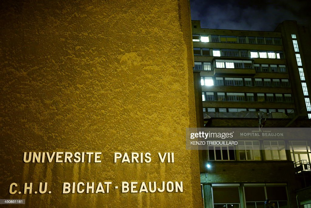 This picture taken on November 20, 2013 shows the Bichat-Beaujon hospital in Clichy, a western Paris suburb, where a man, who was arrested around 7:00 pm (1800 GMT) in a vehicle in an underground parking lot in the western Paris suburb of Bois-Colombes, would have been brought in the evening, according to an AFP photographer. Police on November 20, 2013 arrested a man bearing a 'strong physical resemblance' to the gunman suspected of carrying out several recent attacks in the French capital, the Paris prosecutors' office said. His arrest came after a witness statement to police. Prosecutors said the man was not immediately in a position to be questioned and that the reading of his rights had been deferred, but provided no explanation.