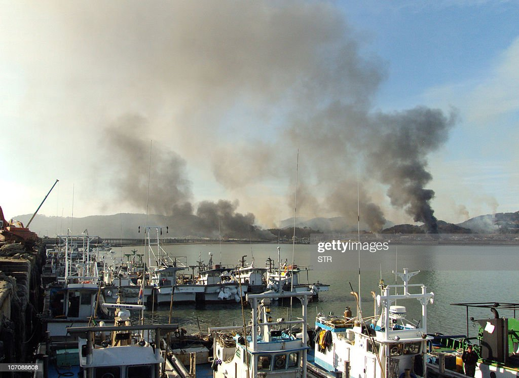This picture taken on November 23 2010 by a South Korean tourist shows huge plumes of smoke rising from Yeonpyeong island in the disputed waters of...