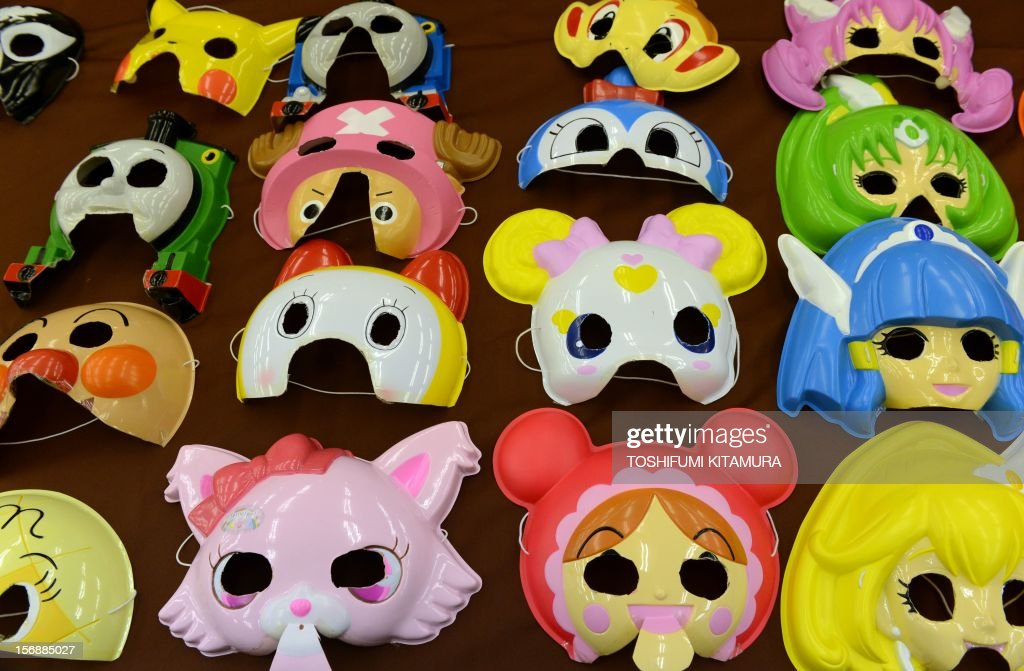 This picture taken on November 23, 2012 shows cartoon character masks displayed on a table prior to a match-making party in Washinomiya, Saitama prefecture, in the northern suburbs of Tokyo. Self-confessed geeks in Japan who might ordinarily be too shy to ask someone on a date are trying a new kind of matchmaking: wearing cartoon character masks.