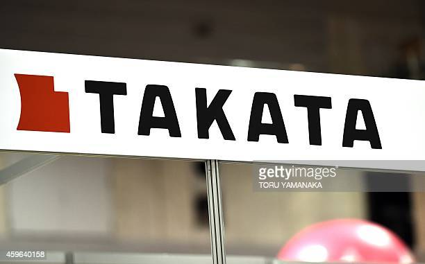 This picture taken on November 23 2014 shows Japanese auto parts maker Takata's logo being displayed at an event in Yokohama suburban Tokyo Toyota...