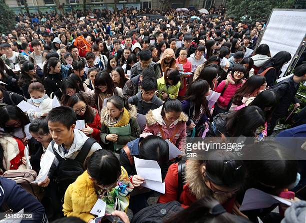 This picture taken on November 24 2013 shows a group of candidates arriving for China's national civil service exam in a university in Nanjing east...
