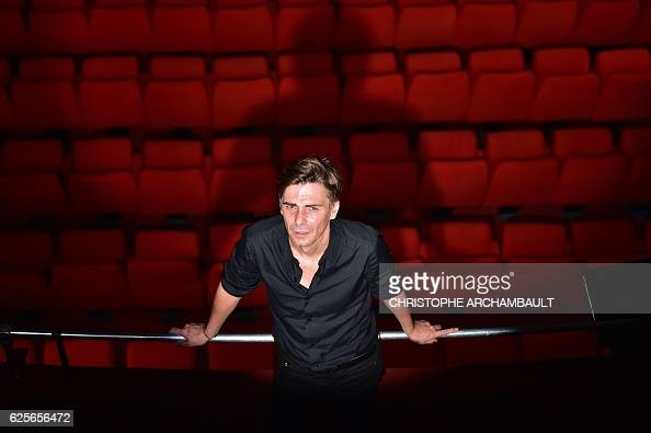 This picture taken on November 24 2016 shows Theatre de la Ville director Emmanuel DemarcyMota posing for pictures at the Espace Cardin in Paris The...