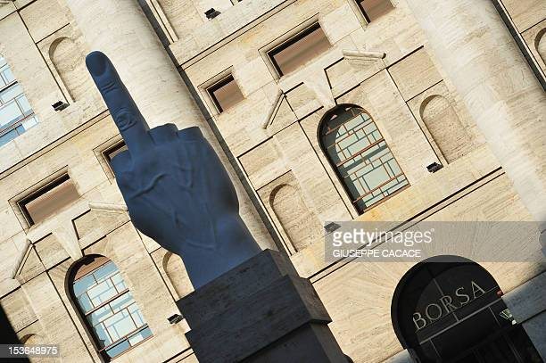 This picture taken on November 25 2011 shows Milan's stock exchange with a sculpture by Italian artist Maurizio Cattelan in front The Bank of Italy...