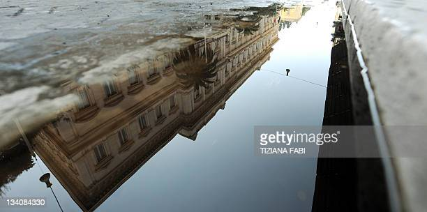 This picture taken on November 25 2011 shows the building of the Bank of Italy in Rome reflected on the pavement The Bank of Italy was forced to pay...
