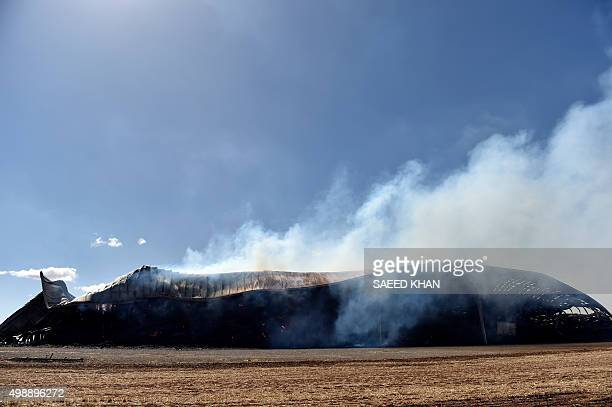 This picture taken on November 26 2015 shows fodder simmering in a godown following bushfires in Freeling north of Adelaide Australians were counting...